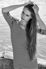 beautiful young woman in striped dress