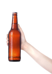hand holding Bottle of beer with drops isolated