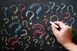Question marks on chalkboard