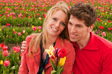 Young love couple in Dutch flower fields
