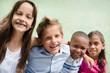 Leinwanddruck Bild - happy children hugging, smiling and having fun