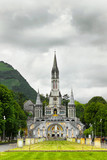 center of pilgrimage to famous cathedral in Lourdes, France. poster