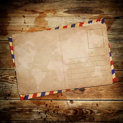 vintage postcard with envelop on wooden background