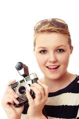 Pretty young woman with vintage camera kit