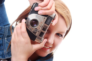 Pretty young woman with vintage camera