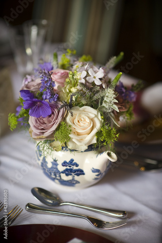 flower bouquet in a teapot