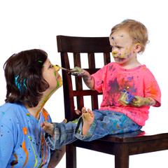 Toddler paints her grandmother's face.