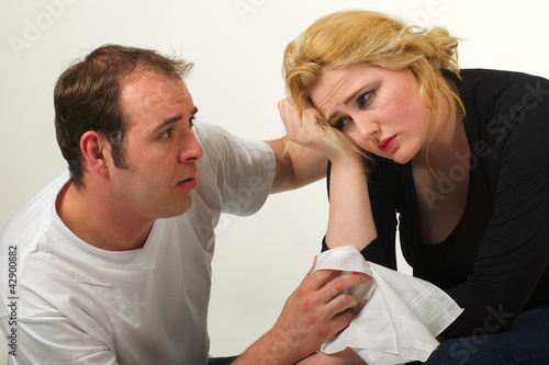 Man comforting woman