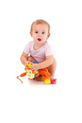 Cute baby girl playing with soft toy