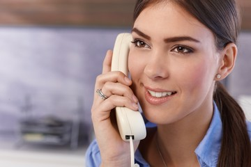Happy woman on landline call