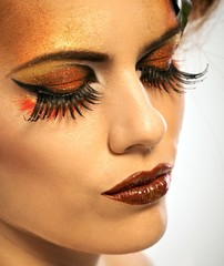 Beauty shot woman in autumn makeup