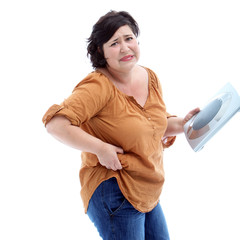 Sad women who are overweight holding scales in her hand