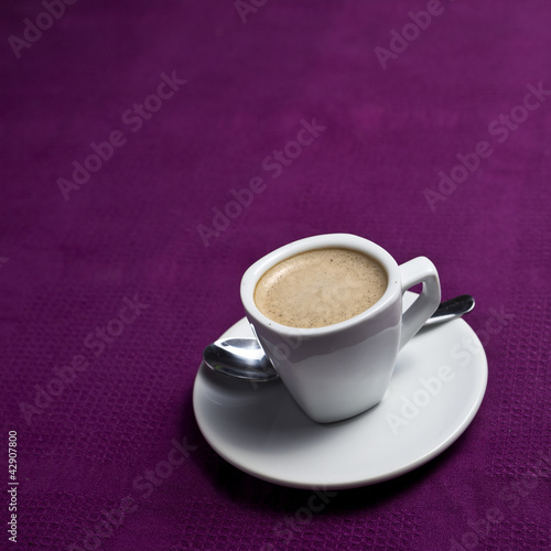 Coffee cup on a purple background