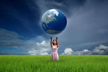 Woman holding the world globe in her hands
