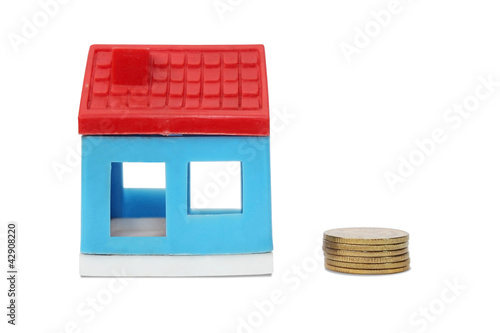 Toy house with coin