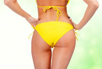 Sexy backside in yellow swimwear