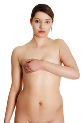 Nude young overweight woman