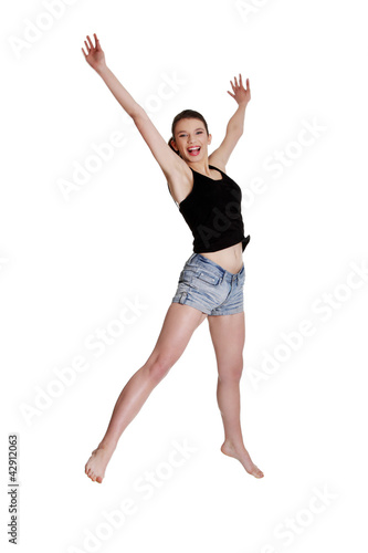 Teen girl jumping for joy