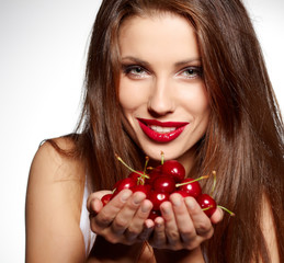 happy woman with cherries over white