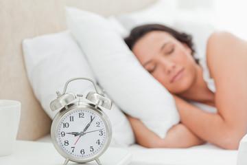 Alarm clock with a woman sleeping