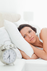 Woman who just wakes up with alarm clock
