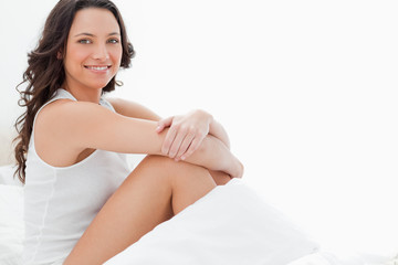 Close-up of an attractive woman sitting in her bed