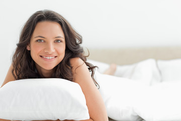 Attractive woman hugging a pillow
