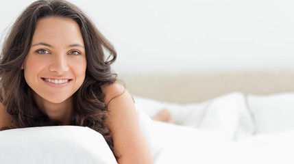 Close-up of an attractive woman hugging a pillow
