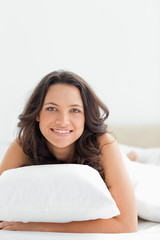 Smiling woman in her bed