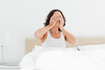 Attractive woman rubbing her eyes