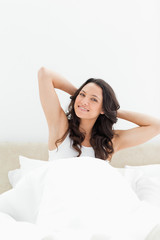 Smiling brunette waking up