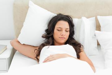 Charming young woman sleeping
