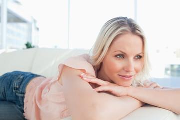 European woman lying on her sofa