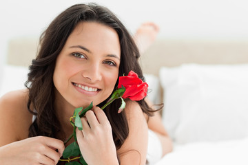 Pretty woman holding a rose