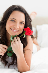 Close-up of a pretty woman holding a rose