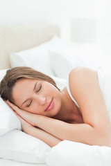 Close-up of a cute woman sleeping deeply