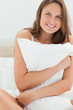 Gorgeous woman hugging a pillow