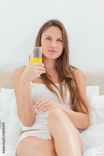 Beautiful woman with a glass of mango juice