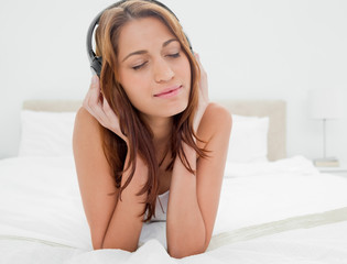 Woman lying on the belly while listening music