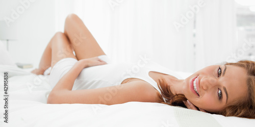 Portrait of an attractive redhead lying on her back