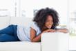 woman lying on her sofa