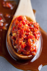 Spoon full of minced chili pepper in oil, calabrian specialty