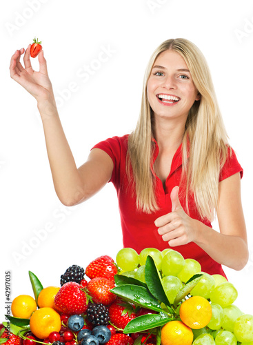 young beautiful woman with fresh fruits and berries