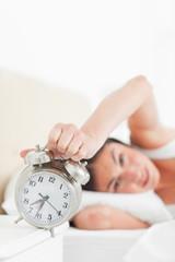 Brunette hating her alarm