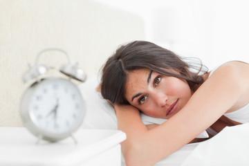 Brunette looking her alarm