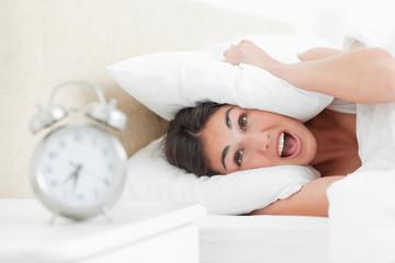 Crazy brunette with her alarm clock