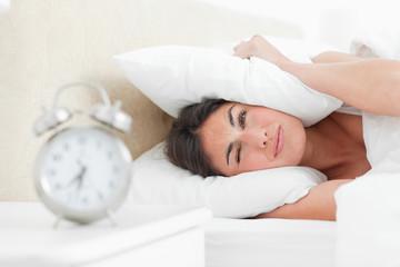 Rude awakening for a brunette with her alarm clock
