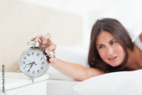 Brunette turning off her alarm
