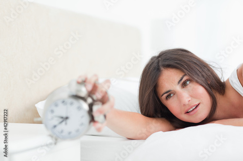 Brunette tries to turn off her alarm