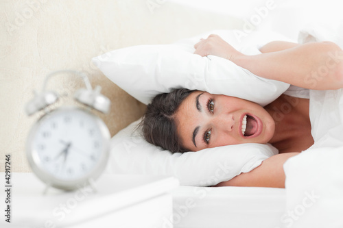 Crazy brunette with her alarm clock